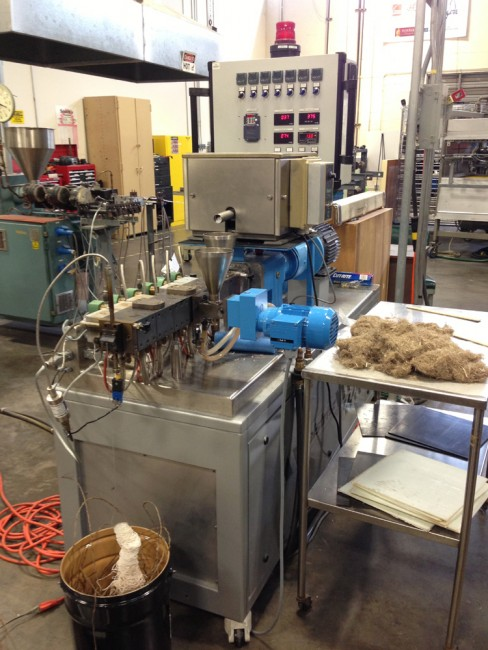 This machine mixes resin with fiber and chops small